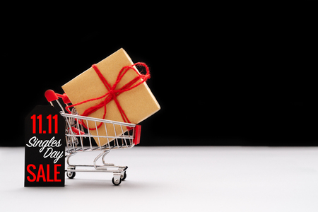 shopping cart and shopping bags with gift box ,China 11.11 single day sale concept Stockfoto