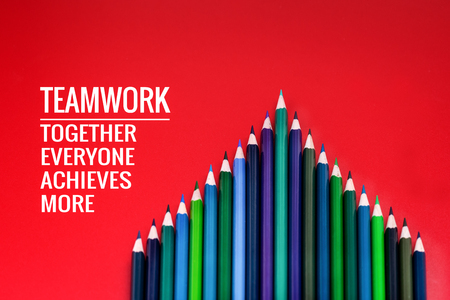 Teamwork concept. group of color pencil on red background with word Teamwork, Together, Everyone, Achieves and More