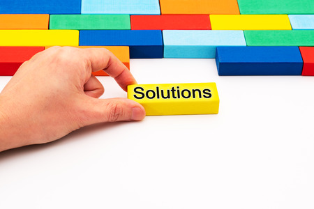 fill in business solutions concept, a piece of wooden block puzzle fit in a blank space Imagens