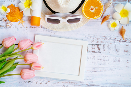 Beautiful summer holiday, Beach accessories, orange, sunglasses, hat and shells on wooden background Imagens
