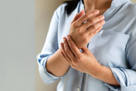 woman wrist arm pain long working. office syndrome healthcare and medicine concept Stock fotó