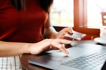 Woman hands holding credit card and using laptop. Online shopping Stock Photo