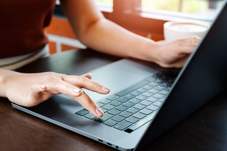 Woman hands office worker typing on the Enter keyboard Stok Fotoğraf