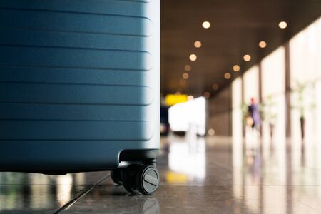 Suitcase in airport departure airport terminal waiting area, ready for vacation, focus on suitcase Stok Fotoğraf