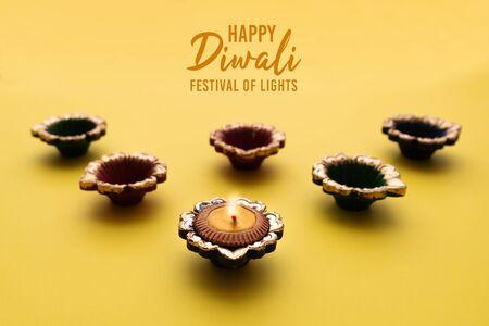 Happy Diwali - Clay Diya lamps lit during Diwali, Hindu festival of lights celebration. Colorful traditional oil lamp diya Stock Photo
