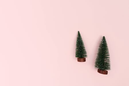 Christmas tree on pink background. Christmas, winter, new year concept. Flat lay, top view