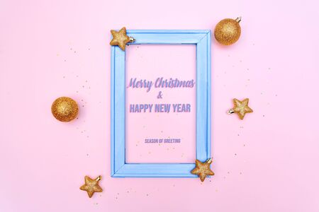 Christmas gold ball and star with photo frame on pink background