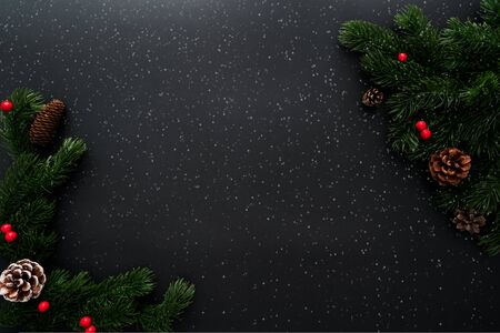 Christmas pine tree with xmas decoration on black background