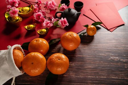 Chinese New Year orange offering red envelope and chinese tea pot Banco de Imagens