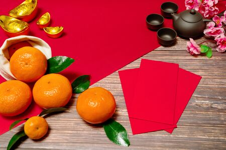 Chinese New Year orange offering red envelope and chinese tea pot, Translation of text appear in image: Prosperity, rich and healthy