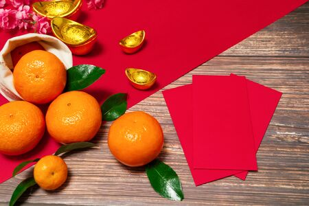 Chinese New Year offering red envelope and orange, Translation of text appear in image: Prosperity, rich and healthy Banco de Imagens