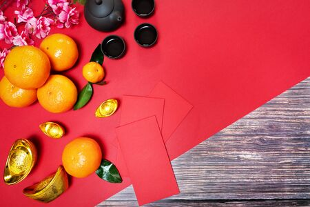 Chinese New Year offering red envelope orange and chinese tea pot, Translation of text appear in image: Prosperity, rich and healthy