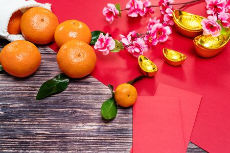 Chinese New Year orange and offering red envelope, Translation of text appear in image: Prosperity, rich and healthy