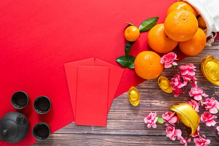 Chinese New Year offering red envelope chinese tea pot and orange , Translation of text appear in image: Prosperity, rich and healthy