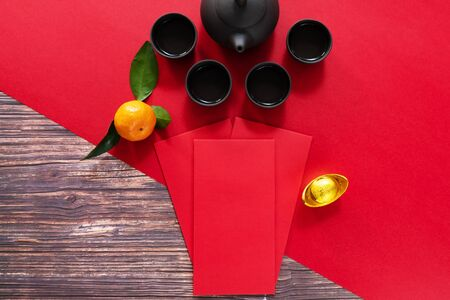 Chinese New Year offering red envelope and Chinese tea pot, Translation of text appear in image: Prosperity, rich and healthy Banco de Imagens