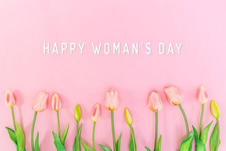Woman Day composition. Tulip flowers on pink background Flat lay top view copy space