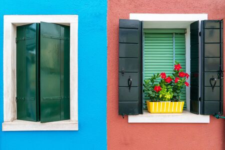 vintage wooden window on colorful cement background