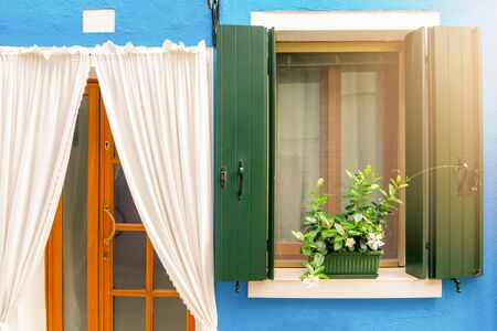 vintage wooden window and white curtain on blue cement background