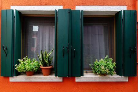 vintage wooden window on orange cement background