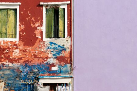 rugged and smooth wall with crack wooden window on colorful cement background