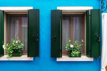vintage wooden window on blue cement background