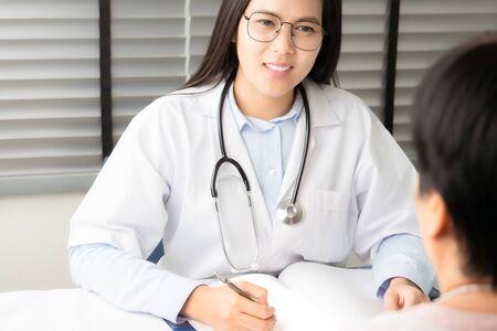Doctor talking to patient hands closeup. Diagnostic, prevention of women diseases, healthcare, medical service and consultation Foto de archivo