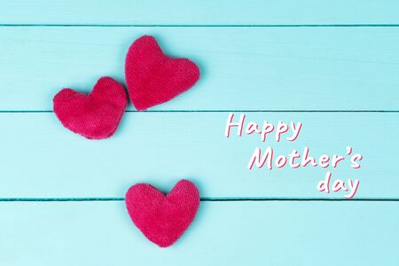 Mothers Day, pink hearts on blue wooden background Banco de Imagens