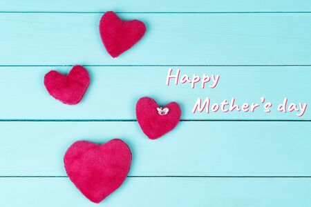 Mothers Day, little flower with pink hearts on blue wooden background Banco de Imagens