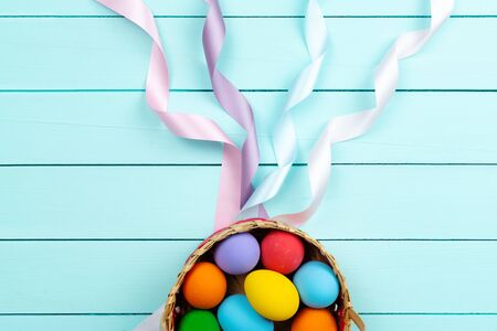 Easter Day Eggs, Decorated colorful Eggs on blue wooden table Banco de Imagens