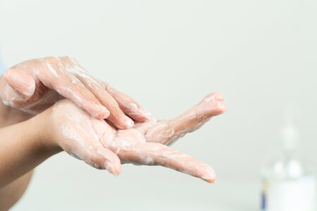 woman clean hand by anti bacteria soap to protect virus, germ, bacteria