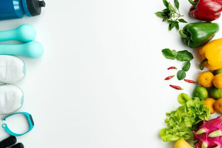 Healthy lifestyle, food and sport concept. athletes equipment and fresh fruit on white background.
