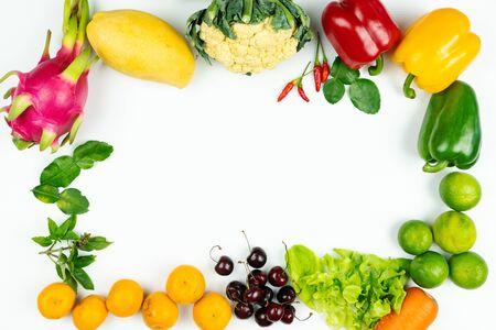 Fresh fruit and vegetable. Frame of fresh raw organic vegetables on white background