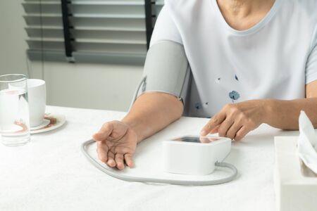 senior woman is detecting blood pressure at home