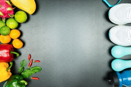 Healthy lifestyle, food and sport concept. athletes equipment and fresh fruit on black background.