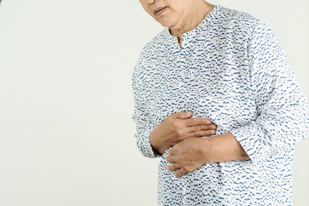 Senior woman Suffering From Acid Reflux Or Heartburn-Isolated On White Background