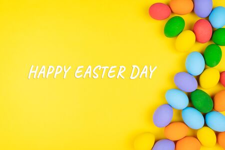 Easter day with decorated eggs on yellow background