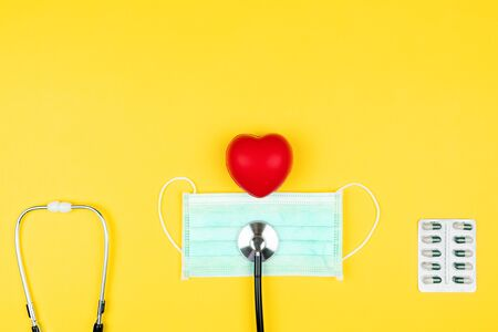 World health day concept Healthcare medical insurance with red heart, stethoscope, mask and medicine