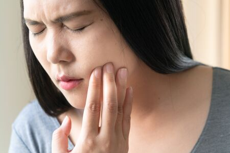 Beautiful woman with suffering from toothache, tooth decay or sensitivity. Women healthcare concept