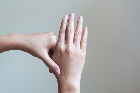 Woman massaging her painful hand. Healthcare and medical concept.
