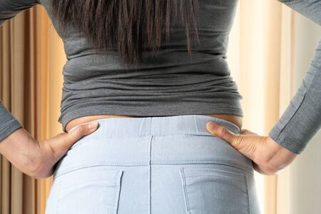 Fat woman with excessive belly fat - rear view. Healthcare and woman diet lifestyle concept