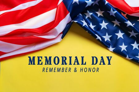 USA Memorial day and Independence day concept, United States of America flag on yellow background Foto de archivo