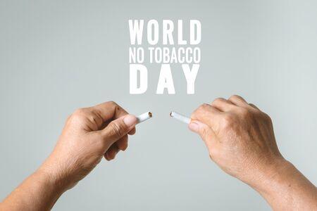 Quit smoking, no tobacco day, mother hands breaking the cigarette Standard-Bild