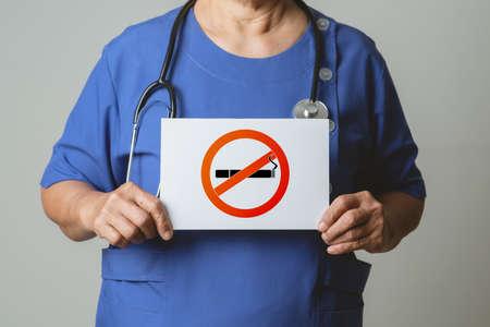 Quit smoking, no tobacco day, doctor holding no smoking sign