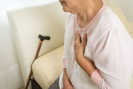 heart attack old woman holding chest in bed room, healthcare problem of senior concept Reklamní fotografie