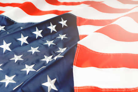 American flag waving in the wind, stars and stripes closeup