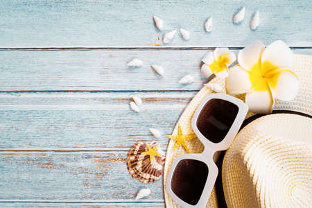 Beautiful summer holiday, Beach accessories, sunglasses, hat and shells on wooden backgrounds