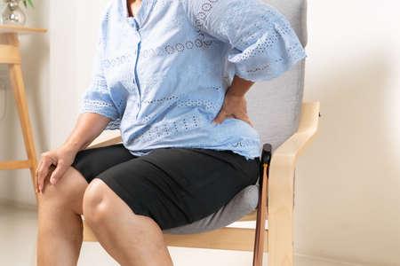 Old woman back pain at home, health problem concept Reklamní fotografie