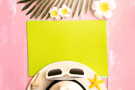 Beautiful summer holiday, Beach accessories, sea shells, hat, sunglasses and palm leave on paper for copy space