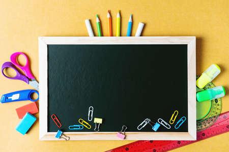 School supplies on black board background. Back to school concept Reklamní fotografie