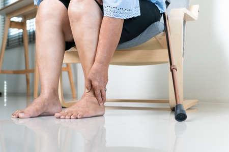Ankle leg pain of senior woman at home, healthcare problem of senior concept Reklamní fotografie